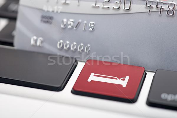 Online hotel foglalás ikon gomb számítógép billentyűzet Stock fotó © tangducminh