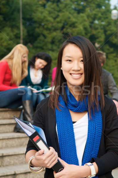 Photo stock: étudiant · notepad · asian · campus · sourire · jeunes