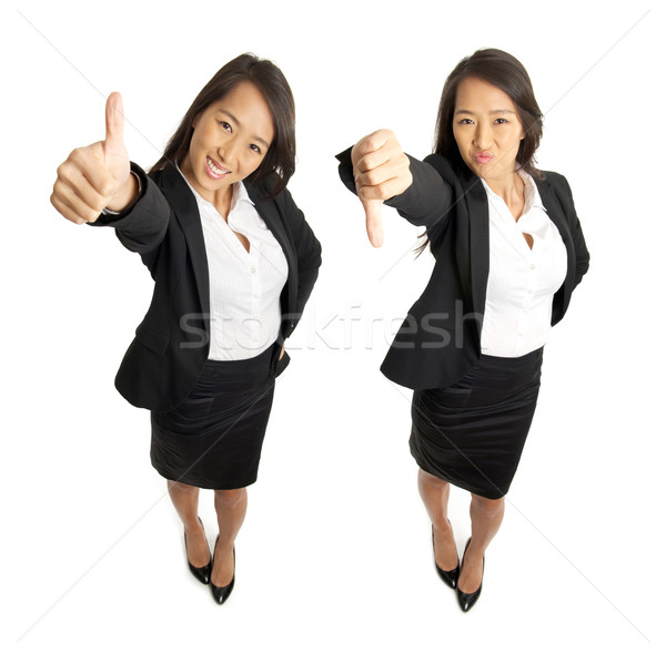 foto de Business woman thumbs up and thumbs down stock photo