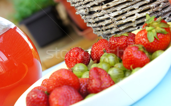 Strawberries, gooseberry, basket and compote Stock photo © tannjuska