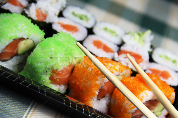 Mix of Japanese sushi and rolls Stock photo © tannjuska