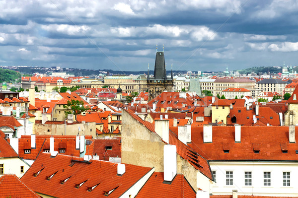 Stock photo: Prague roofs and cloudy sky