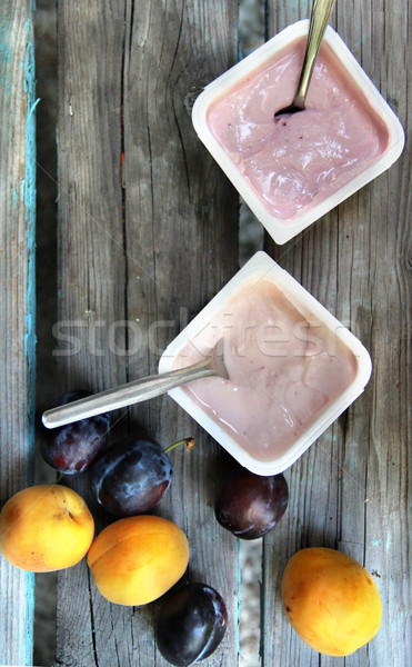 Yoghurts on the wooden table Stock photo © tannjuska