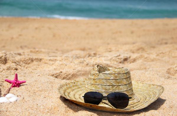 Seacoast and straw hat  Stock photo © tannjuska