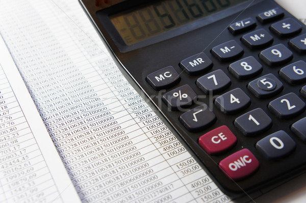 Office table with calculator and accounting document   Stock photo © tannjuska