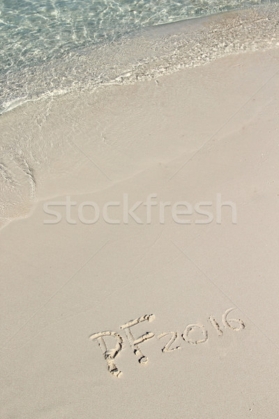 Handwriting inscription PF 2016 on the beach Stock photo © tannjuska