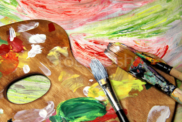 Art palette, paintbrushes and picture with flowers Stock photo © tannjuska