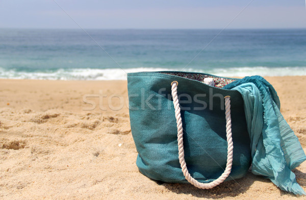Blue beach bag on the seacoast and shawl   Stock photo © tannjuska