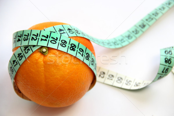 Fruit and measurement tape on the white background Stock photo © tannjuska