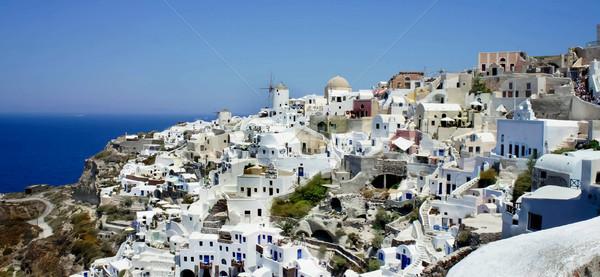 Santorini gyönyörű fehér házak fal tájkép Stock fotó © tannjuska