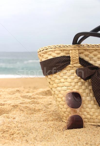 Seacoast, straw beach bag and sunglasses  Stock photo © tannjuska