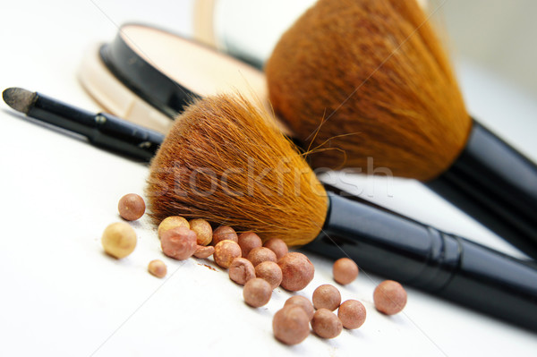 Makeup foundation, powder, bronzer and brushes Stock photo © tannjuska