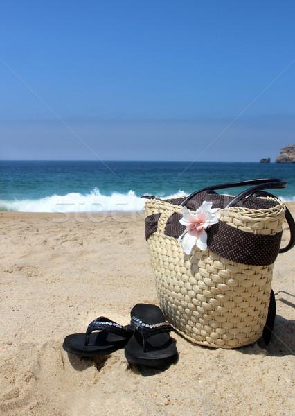 Seacoast, straw beach bag and flip-flops Stock photo © tannjuska