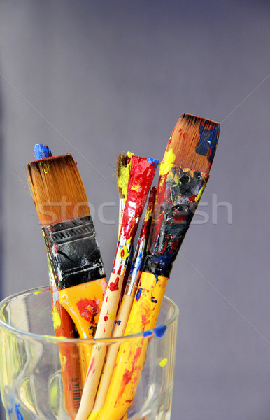 Mix of paintbrushes stained with paints  Stock photo © tannjuska