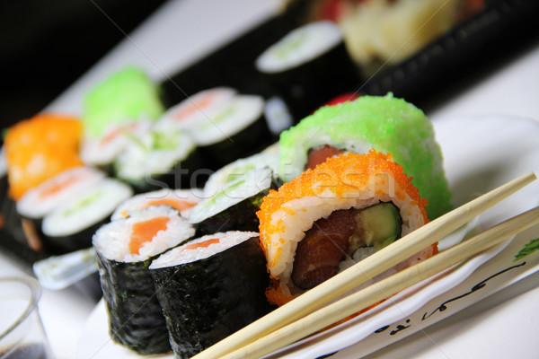 Mix of Japanese sushi and rolls Stock photo © tannjuska