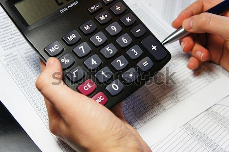 Office table with calculator, pen and accounting document   Stock photo © tannjuska