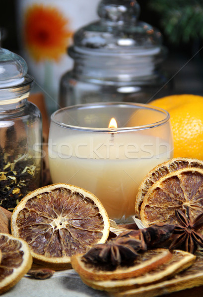 Candle, cinnamon sticks and dry orange Stock photo © tannjuska