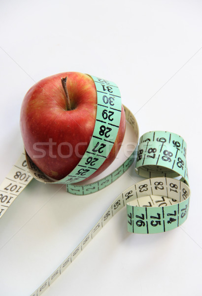 Apple and measurement tape on the white background  Stock photo © tannjuska