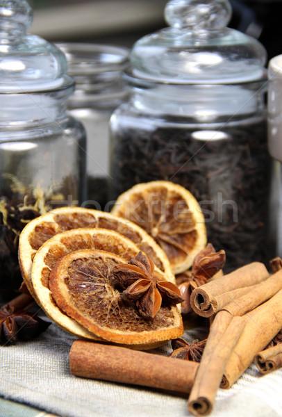 Tea leafs, cinnamon sticks and dry orange Stock photo © tannjuska