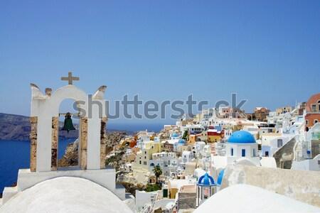 Amazing small white houses of Santorini Stock photo © tannjuska