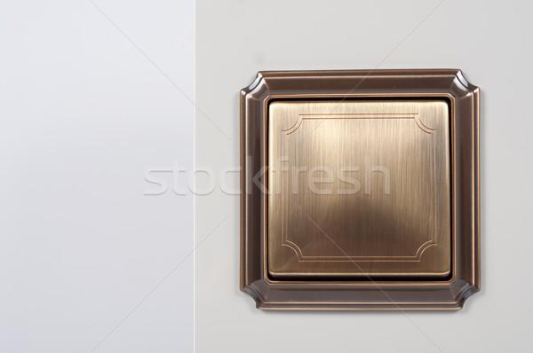 Cobre retro interruptor de la luz pared Foto stock © tarczas