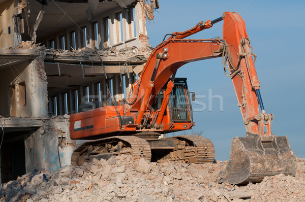 digger working during the demolition of the building Stock photo © tarczas