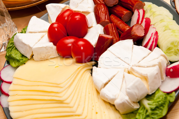 platter of cold cuts cheese and sausages with ham and tomatoes Stock photo © tarczas