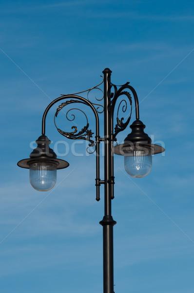retro street lamp on blue sky background Stock photo © tarczas
