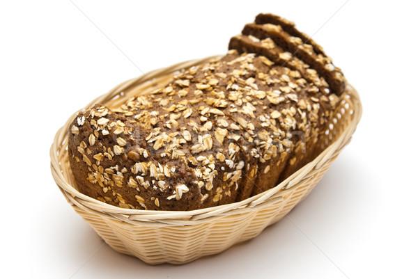 Teljeskiőrlésű kenyér fonott kosár szeletel háttér Stock fotó © tarczas
