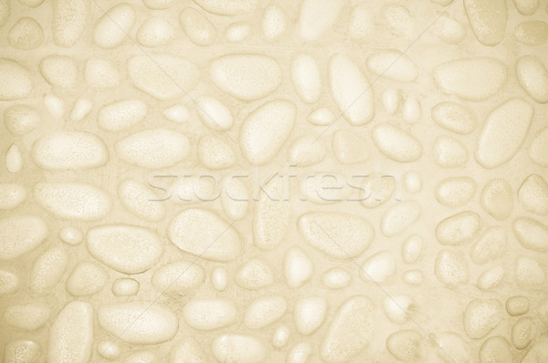 textured stone wall background with small stones and cement  Stock photo © tarczas