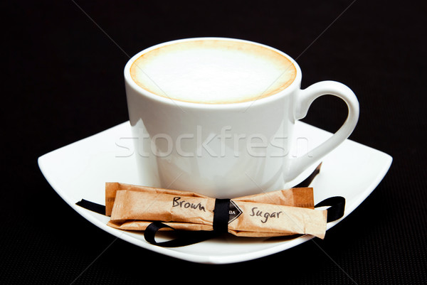 cup of cappuccino coffee with brown sugar portion Stock photo © tarczas