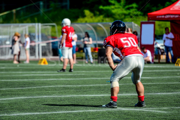 american football player with out of focus players in the background  Stock photo © tarczas