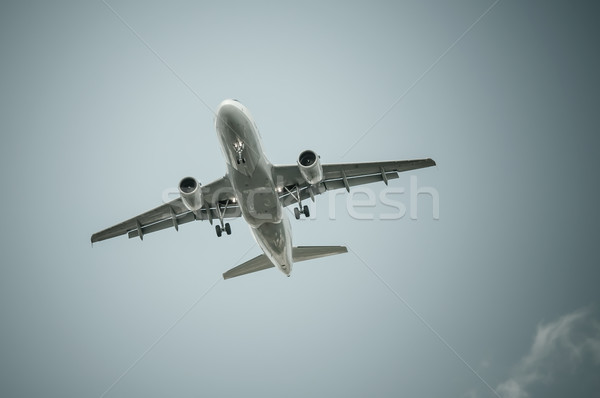 Big airplane in the sky - Passenger Airliner / aircraft  Stock photo © tarczas