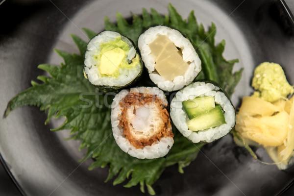 Sushi maki rolls with salmon, avocado and prawns Stock photo © tarczas