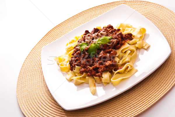 spaghetti bolognese with cheese on white plate Stock photo © tarczas