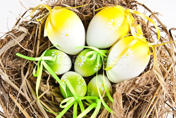 Stock photo: easter eggs in nest