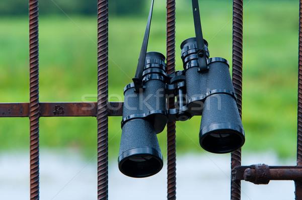 binoculars hanging on metal grating Stock photo © tarczas