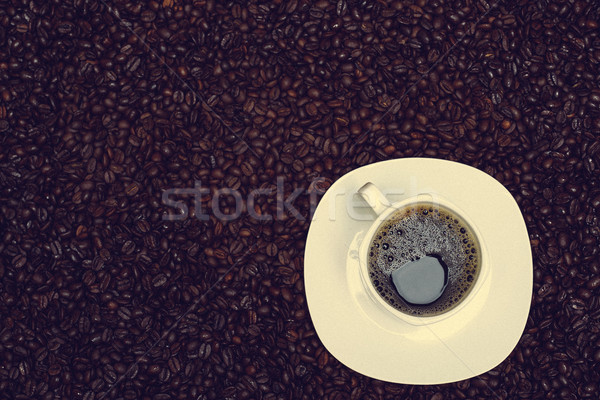 coffee beans background and cup with hot drink Stock photo © tarczas