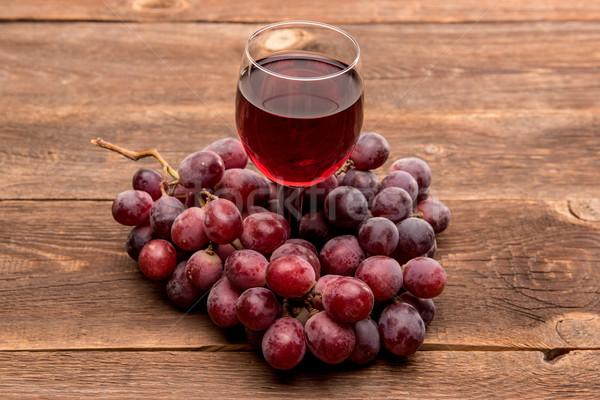üveg bor szőlőlé gyümölcs fa asztal étel Stock fotó © tarczas