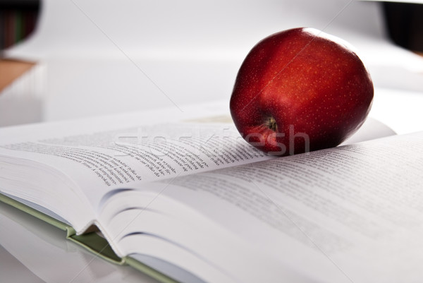 open book and red apple Stock photo © tarczas