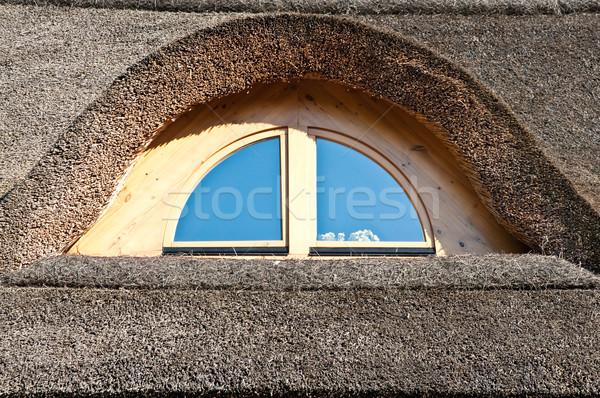 window on the straw roof Stock photo © tarczas