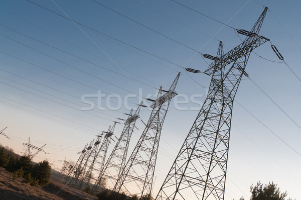 Pylon and transmission power line in sunset Stock photo © tarczas