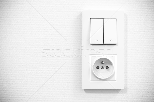 light switch and socket in frame on the wall Stock photo © tarczas