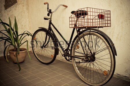 old retro bicycle leaned the wall Stock photo © tarczas