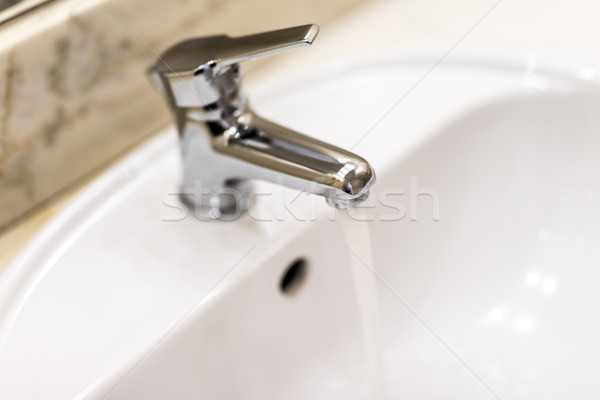 washbasin and faucet with water drop at home Stock photo © tarczas