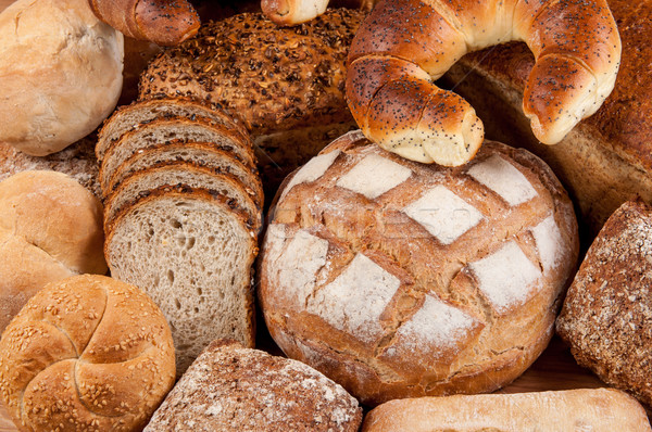 Group of different bread's type on wooden table Stock photo © tarczas