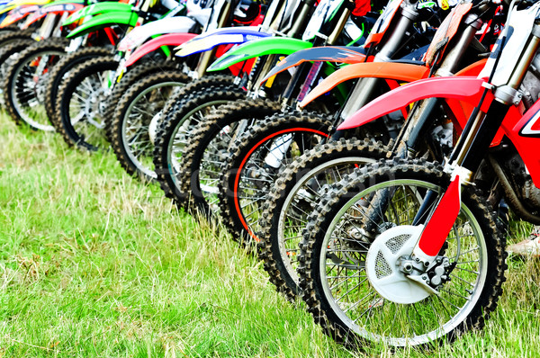 Motocross riders lined up before start on the race Stock photo © tarczas