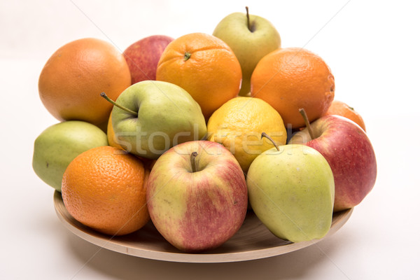 Tasty fruit orange, apples and banana on the wooden plate Stock photo © tarczas