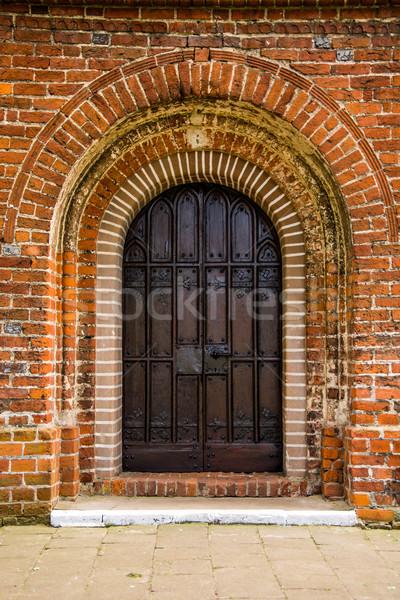 old door of medieval Cistercian monastery in Kolbacz, Poland Stock photo © tarczas