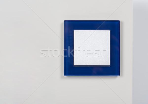 Interrupteur de lumière bleu verre cadre mur maison Photo stock © tarczas